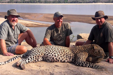 TJ Schwanky, with Patty (L) and Stephan (R) and his close-encounter leopard